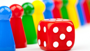 Game pieces (blue, red, green and yellow) and a red dice